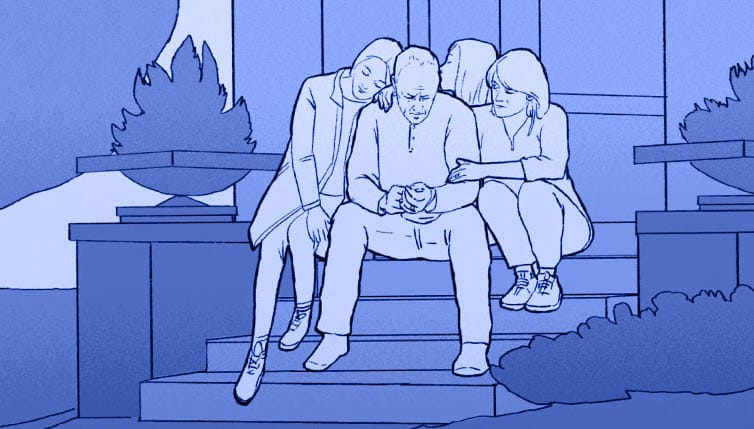 group sits on steps